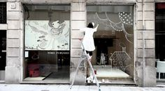 Live store window painting