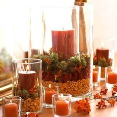 Layer seasonal materials in glass cylinders for your Thanksgiving centerpiece or fall mantel. For more decorating ideas: http://www.midwestliving.com/homes/seasonal-decorating/dried-corn-projects/?page=14