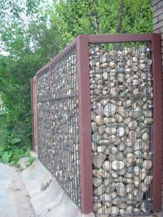 My Great Outdoors: Josh  Heather's DIY Gabion Fence | Apartment TherapyVery much like the idea of a rock fence.