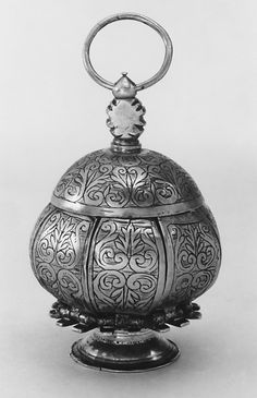 Pomander  Maker: S. B.     Date:      ca. 1580  Culture:      English (London)  Medium:      Silver  Dimensions:      H. 2 1/2 in. (6.4 cm)  Classification:      Metalwork-Silver  Credit Line:      Gift of Irwin Untermyer, 1968  Accession Number:      68.141.321