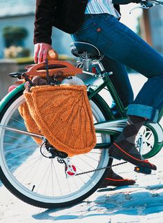 Get out of here! That's pretty hipster, but it's also pretty sweet.  Vogue Knitting bicycle pannier