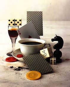 Assemblage of dice, playing cards and game pieces, coffee, alcohol & tobacco. Photography by Irving Penn.