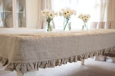 fitted ruffled linen table covering- this is really pretty