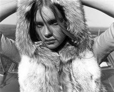 Natalia Vodianova by Carter Smith styled by Edward Enninful   girl   young   fur   shy   sweet   kicking back   posing  