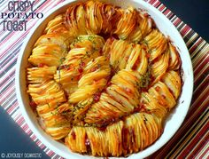 """Crispy Potato Roast: thinly sliced potatoes are studded w onions & pancetta (bacon's fine too), sprinkled w salt & red pepper flakes then brushed w butter & baked to crispy perfection. """"This is a dish that is super impressive-looking and would really wow at a dinner party!""""~blogger"""