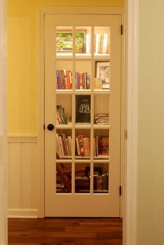 Make a library out of a closet and add a french door.