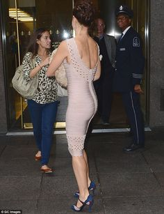 Ashley Judd incredible figure in a skin tight bandage dress and high heels