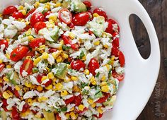 Summer Tomatoes, Corn, Crab and Avocado Salad - A wonderful summer salad made with lump crab meat, summer tomatoes, sweet charred roasted corn, cilantro, hot peppers and zesty lime juice. Serve this over mixed greens or tostadas as a main dish or you can put this in martini glasses as a fancy appetizer.