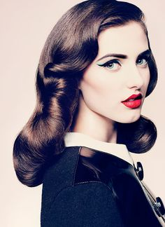 Love the blue winged eyeliner and a red lip!
