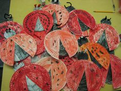 paper-plate ladybugs! cut paper plates in half and use cardstock for the center black circle and for the head. punch holes for antenna pipe cleaners