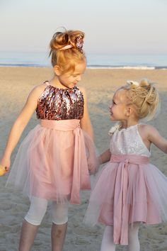 Pillowcase dress turned sequin flower girl dress! Get the DIY!