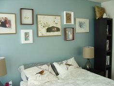 Pretty bedroom :-) The blue wall is painted in a pearlescent paint which gives it a great color & shimmer at night.  Benjamin moore color: Latex Metallic Pearlescent Tint Base in Icy Mist.