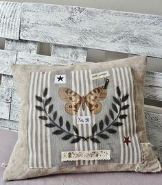 cute pillow in an antique grain sac style
