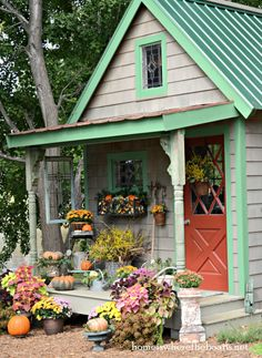 gorgeous fall porch decor ~ this is just the potting shed!