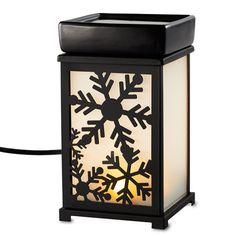 """Hidden LED light provides soft illumination for changeable black metal panels on frosted glass: birds, snowflakes and scrolls. Electric warming plate diffuses the fragrance of Scent Plus® Melts or scented oil, sold separately.  6 3/4 """"h, 3 3/4""""sq..    Download FREE Expressions inserts!  Price:  $40.00 each"""