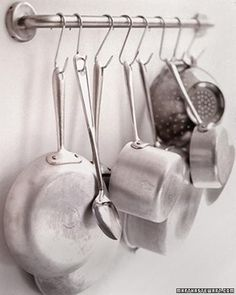Turn a few square feet of wall into a convenient rack for kitchenware with just a handrail and S-hooks.