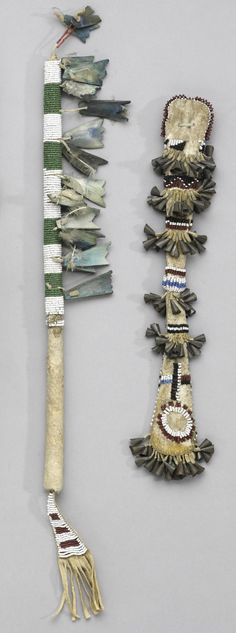 Two Plains beaded items  Including an Apache awl case, with bands of beading and rows of tin cone tinklers; and a Sioux rattle, the bead-wrapped upper section hung with painted cuts of horn.  length 13 1/2 and 19 1/2in