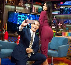 Frame-worthy. Andy Cohen got up close and personal with Kim Kardashian during Watch What Happens Live. The host snapped a butt selfie of the reality star — and she didn't seem to mind!