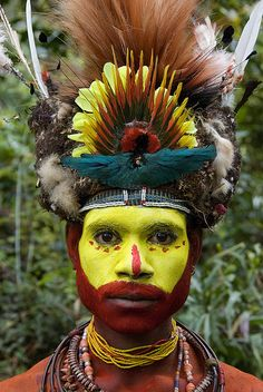 Website for this image  Papua New Guinea PNG yellow painted faces traditional paintings tribal faces ...  greenimagebank.com