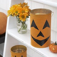 Homemade Halloween crafts: Jack-o'-lantern Cans. Give the porch an eerie glow with these spooky lights made out of a tin can.