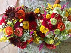 zinnia bouquets… Red sunflowers, not sure if we will have them blooming in 3 weeks or not, but they could be an option!