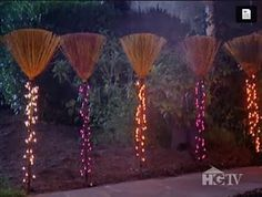 Witch's brooms lit and lined along the walkway... I love this idea