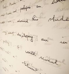 Painstakingly sliced sentences by Oakland artist Annie Vought. In some of her works the lines on the paper provide a natural structure for a single piece and in others individual words are glued to pins. How obsessive compulsively awesome