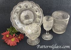 This is four pieces of the flint Bellflower pattern made by the Boston Sandwich Glass Co. ca. 1860-1910.  This is a plate, master salt, wine goblet & tumbler.