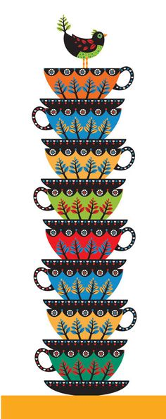 Colorful teacups with a bird on top