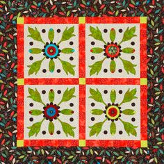 Showcase a large fussy-cut flower in the center of each of these whimsical blooms, then highlight all of the appliqués by using black machine-blanket-stitching.