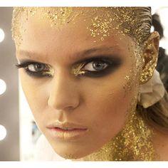 Gold leaf style runway make - up.