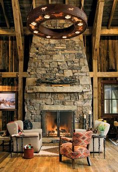 Love this beautiful rustic stone fireplace | Stylish Western Home Decorating
