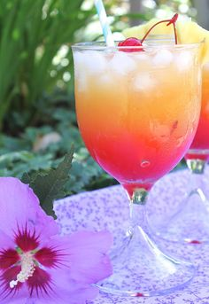 Tropical Island (1 oz coconut rum 1 oz spice rum  1 oz banana liqueur 2 oz pineapple juice 2 oz orange juice a splash of grenadine)