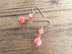 Handmade artisan dangle earrings with 14k gold fill wire work and lovely coral beads. Simple and elegant earthy jewelry.
