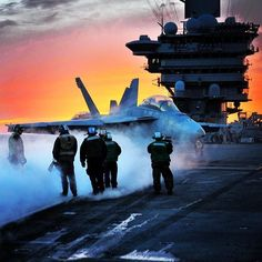 An F/A-18 Super Hornet is directed onto the catapult on the flight deck of the aircraft carrier USS Theodore Roosevelt. The Super Hornet is an attack aircraft, as well as a fighter. #Navy #USNavy #AmericasNavy navy.com