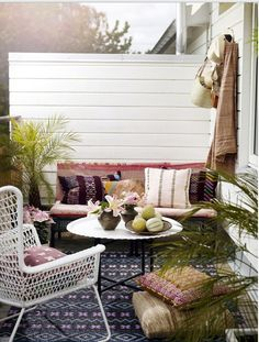 One can easily transform an outdoor space into an exotic retreat starting with a great area rug and layering textures and accessories that reflect a certain far off destination!