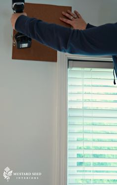 Make a template to hang curtain rods so they are the same height and distance from the window.