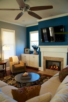 living room: blue accent wall...wanting to use this color on our family room walls.
