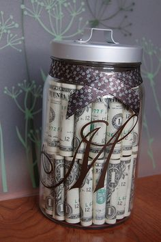gift for any age  jar, ribbon, and a pillar of card-stock filled with  candy (like jellybeans or Hershey kisses) to support the $. Have each dollar represent each year.
