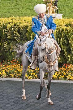 President of Turkmenistan with his favourite Akhal-Teke stallion.
