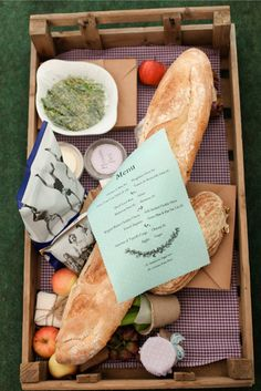 Great idea for wedding food ~ each table has its own rustic wedding picnic in a vintage crate, with a few handmade touches. Found on The Natural Wedding Company #weddingfood #reception
