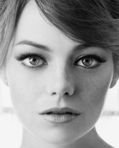 Emma Stone's doe-eyed make-up look has an Audrey Hepburn feel to it.  perfect for a wedding!