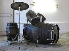 Old Barrels repurposed into a drum set! I wonder how it sounds!