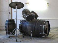 Old Barrels repurposed into a drum set! I wonder how it sounds!