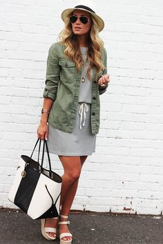 Army green coat with stripe dress.