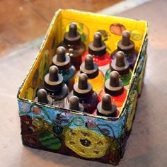 "Decorated box filled with ink bottles, a short ""How To"" by Peony and Parakeet"