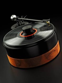 The German brand Analog Manufaktur Germany (AMG) introduced their latest beautiful turntable called Viella 12. The designer behind the brand, Werner Roeschlau offers us something simple and classic but beautiful lines, reminding a lot the turntables from New York store BDDW.