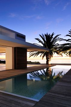 Contemporary pool design with clean lines and a magnificent view. Pinned to Pool Design by Darin Bradbury.