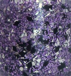 purple glitters, silver shreds, and black diamonds in a clear base.