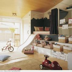 Playroom with awesome built ins and open to the backyard!